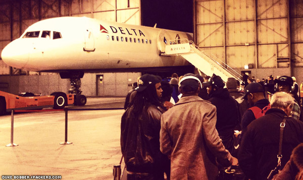 The Packers board their charter flight at O'Hare International Airport Sunday evening