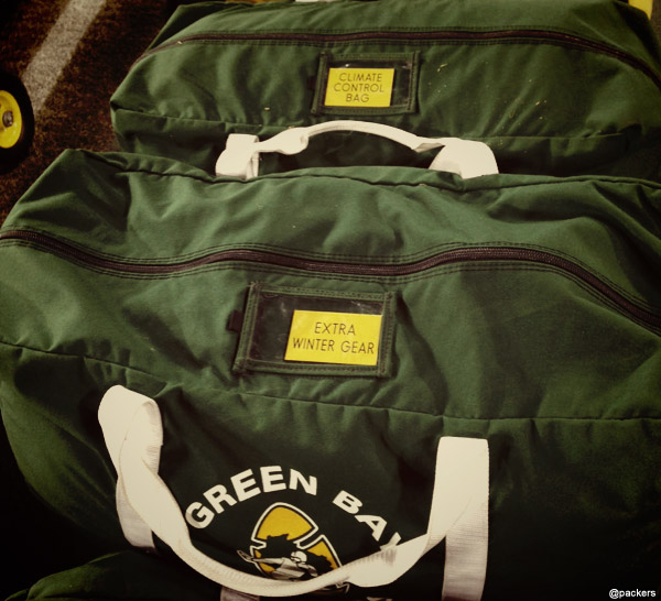 Bags of equipment line the Packers' sideline at Lambeau Field