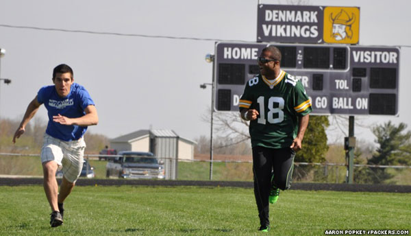 Randall Cobb races a student at Denmark High School