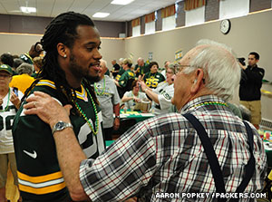 RB Alex Green talks with a fan at the Behring Senior Center