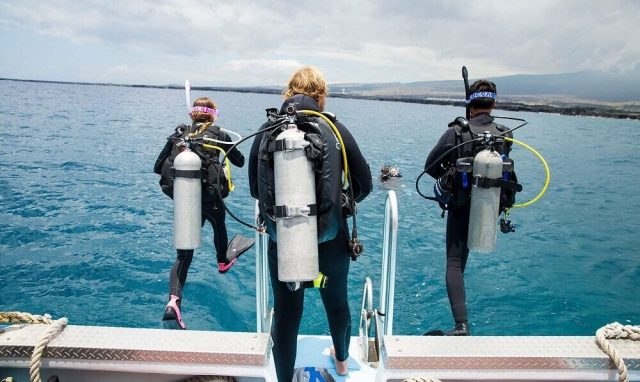 Divers step off a boat