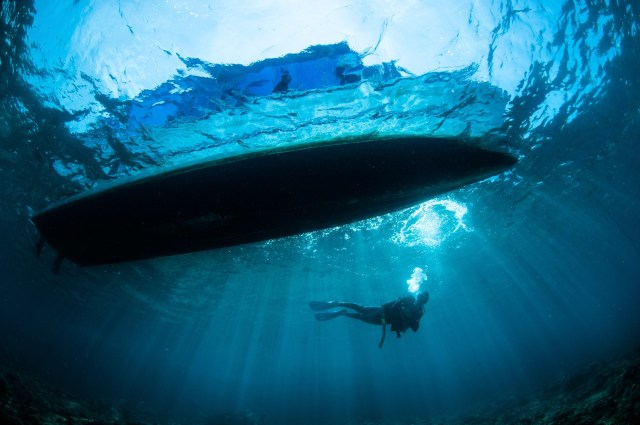 diver on a boat dive in Indonesia