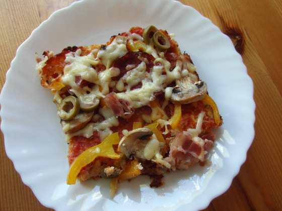 Další kousek pizzy