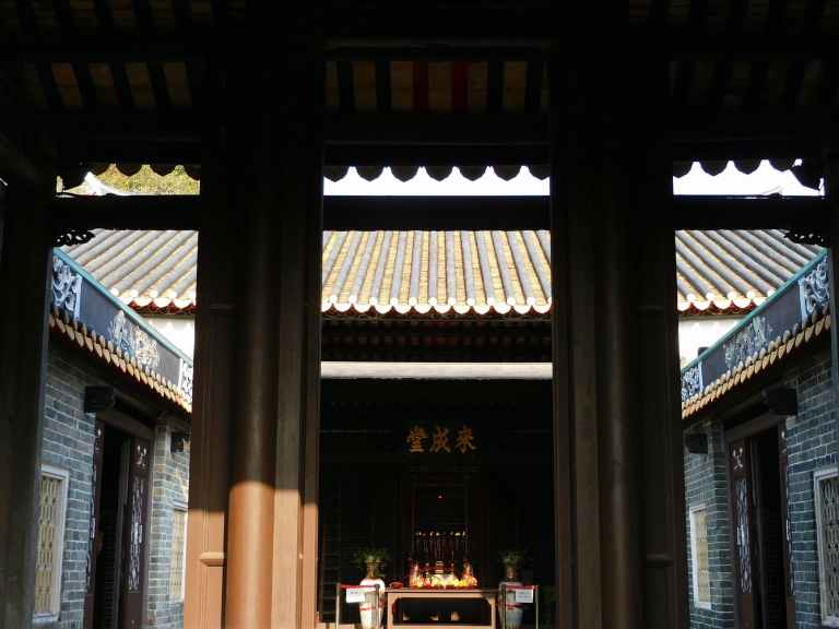 yard of buddhist temple on sunny day