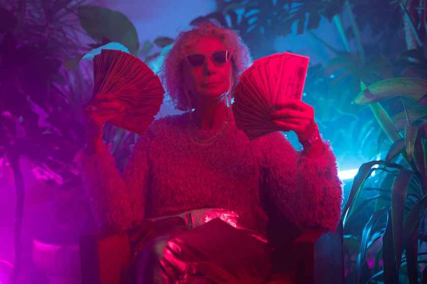 photo of an elderly woman holding money