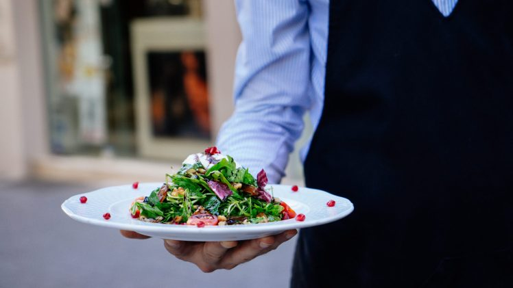 Server job description: Waiter holding salad