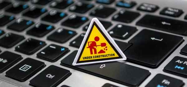 under construction signage on laptop keyboard