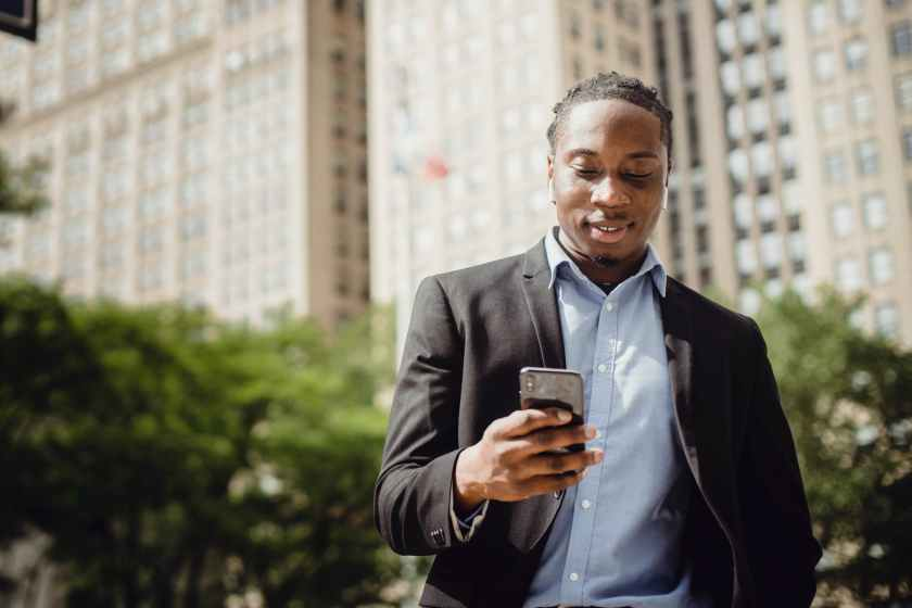 content young man using smartphone and listening to music