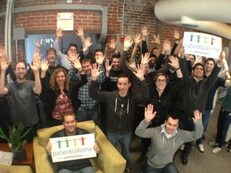 PatientsLikeMe Employees Raising Their Hands for Rare Disease Day 2013
