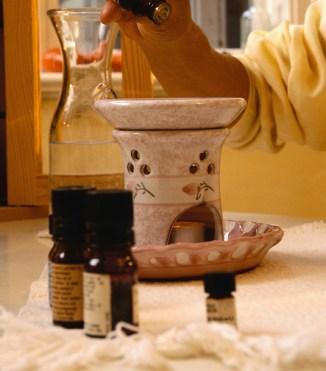 Adding essential oils to an aroma lamp