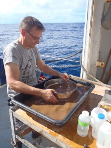 Dr Thomas Dahlgren sieving sediments to find new clam and snail