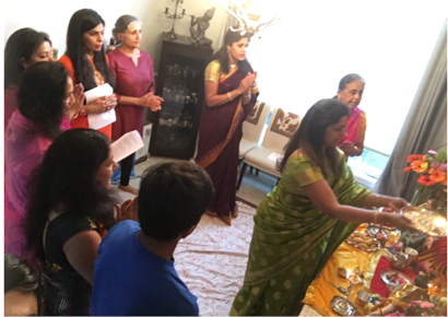 Swarnima and group of women standing in front of the idols