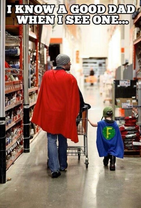Dad and son in matching superhero outfits