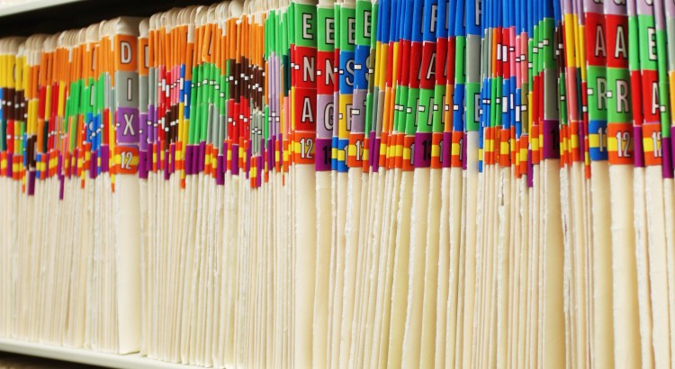 A row of colored medical records folders