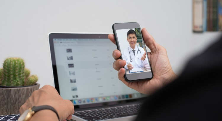 Telemedicine. Image of a patient speaking to a doctor on a mobile phone.