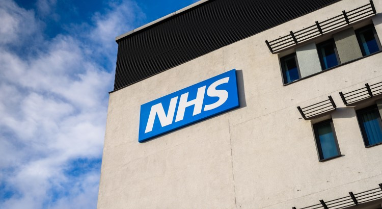 NHS logo on the side of a building
