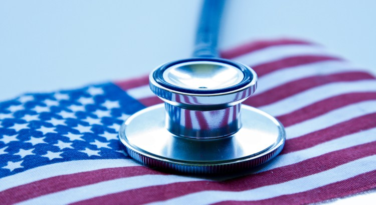 Close-up of a stethoscope on an American flag