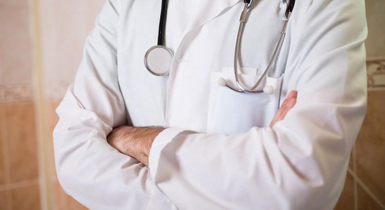 Doctor in white coat neck down