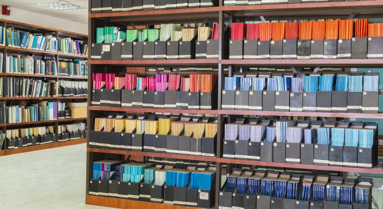 Photograph of colorful academic journals on a library shelf