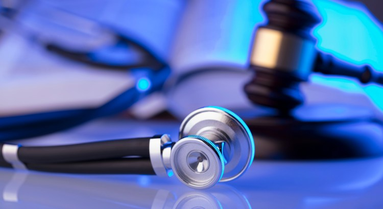 Photo of a stethoscope, gavel, and book