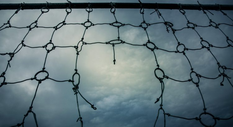 Broken, frayed net, representing a broken social safety net