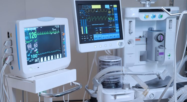 hospital equipment, including heart rate monitor and oxygen monitor functioning at bedside.