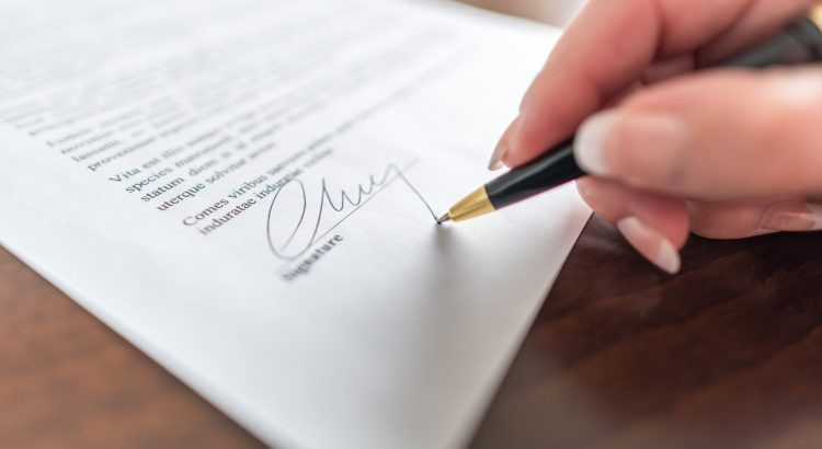 Hand signs a contract