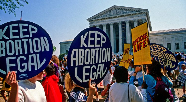 Washington DC.,USA, April 26, 1989. Supporters for and against legal abortion face off during a protest outside the United States Supreme Court Building during Webster V Health Services.