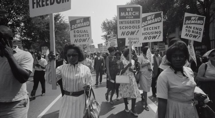 Civil rights march on Washington, D.C. Film negative by photographer Warren K. Leffler, 1963. From the U.S. News & World Report Collection. Library of Congress Prints & Photographs Division. Photograph shows a procession of African Americans carrying signs for equal rights, integrated schools, decent housing, and an end to bias. https://www.loc.gov/item/2003654393/