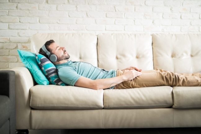 man lying on couch.
