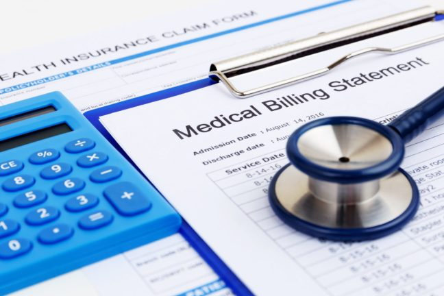 Medical bill and health insurance claim form with calculator.