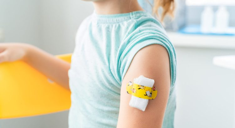 Child with bandaid on arm.