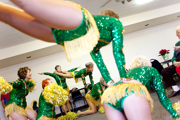 Photo by Kendrick Brinson/The Sun City Poms, ages 61–78, perform a routine for a crowd on Dec. 12, 2009