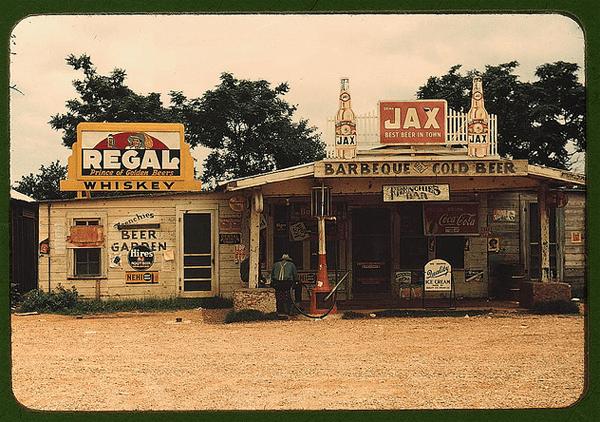"Photo by Marion Wolcott/A cross roads store, bar, ""juke joint,"" and gas station in the cotton plantation area, Melrose, La., 1940 June"