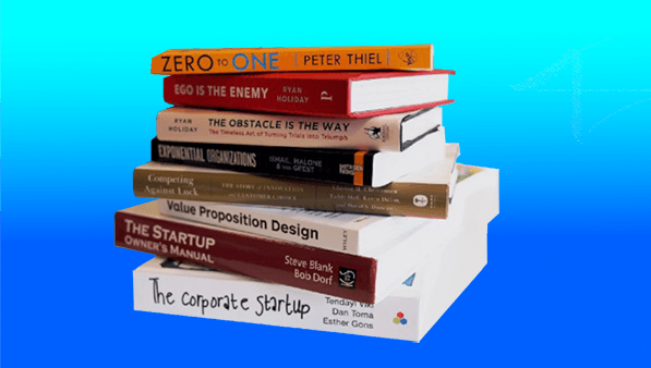 a stack of start up and design books