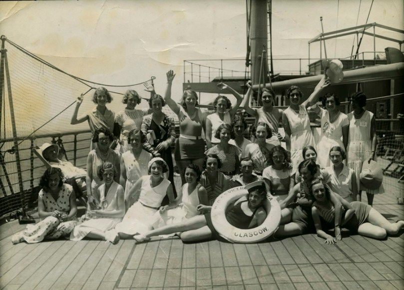 Women waving on a P&O ship in the 1920s