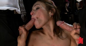 Greedy whore sucks off two cock while being on her knees in public, at a party