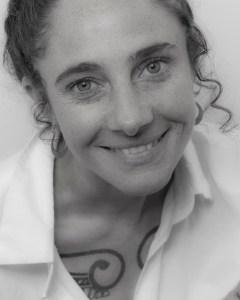 Black and white headshot of Aviva Reed