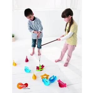 a boy and a girl fishing for plastic toy fish, crabs, starfish, and bait