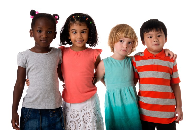 Children of different cultural backgrounds embracing each other