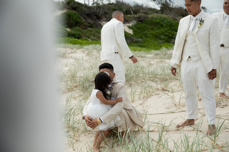 candid-moment-between-flower-girl-beach-elements-of-byron-bay-quincenmulberry
