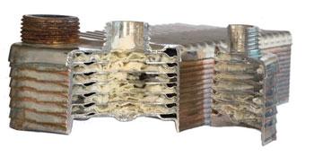 Limescale buildup inside heat exchanger coil