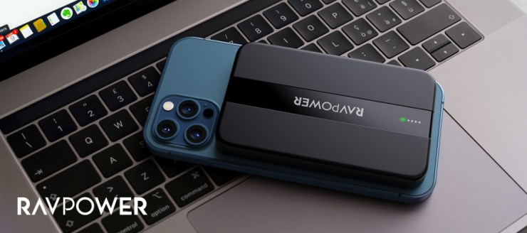 iPhone 12 face down on a laptop keyboard with a magnetic wireless power bank attached