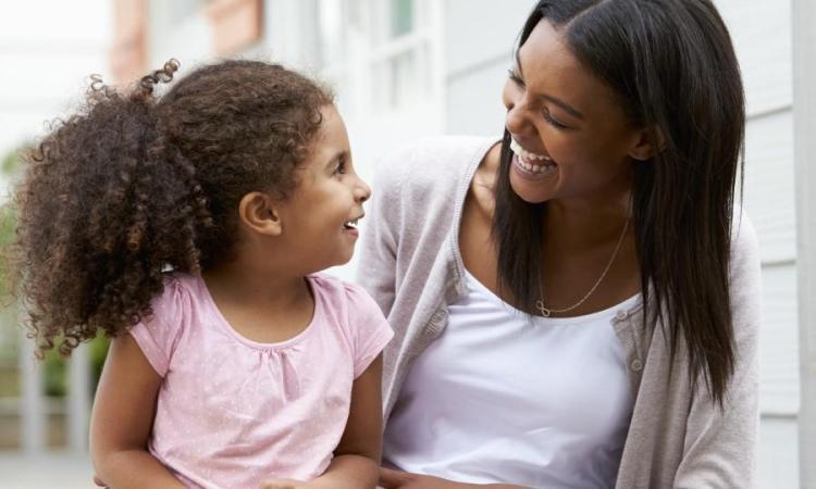 Adult woman and child talking