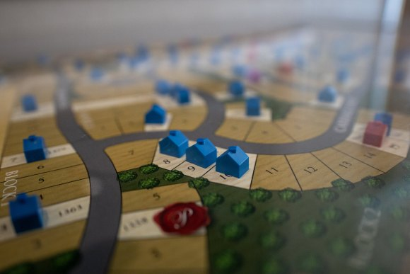 home pieces on a gameboard