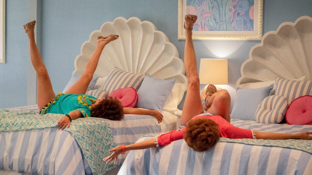 Barb & Star Go to Vista Del Mar (Kristen Wiig and Annie Mumolo laying on a bed)
