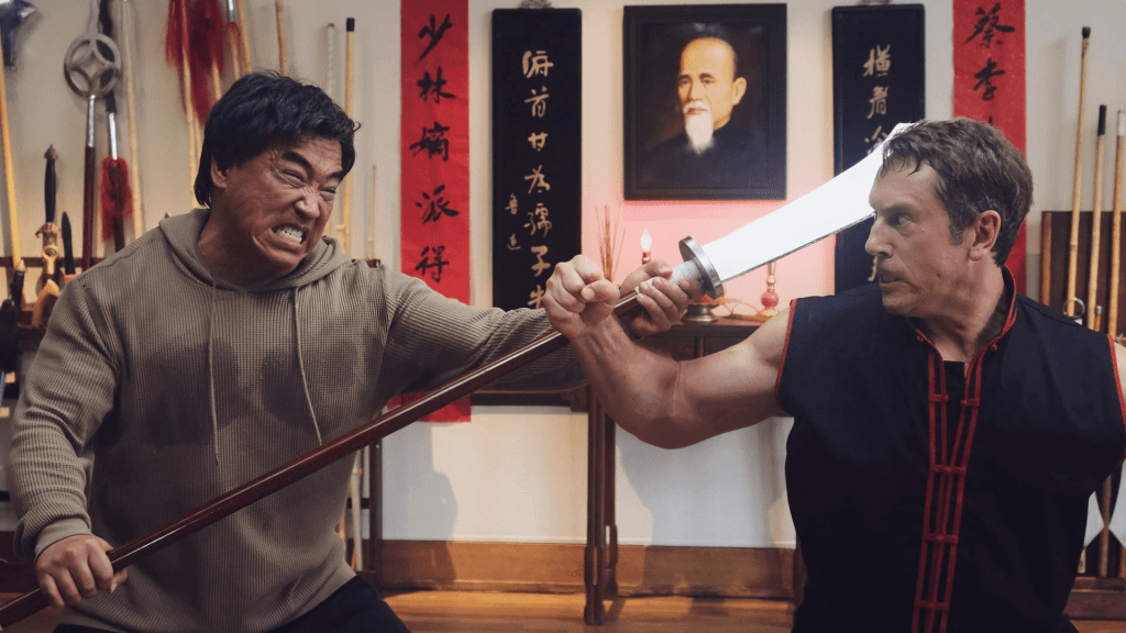 Two men in Paper Tigers fighting.