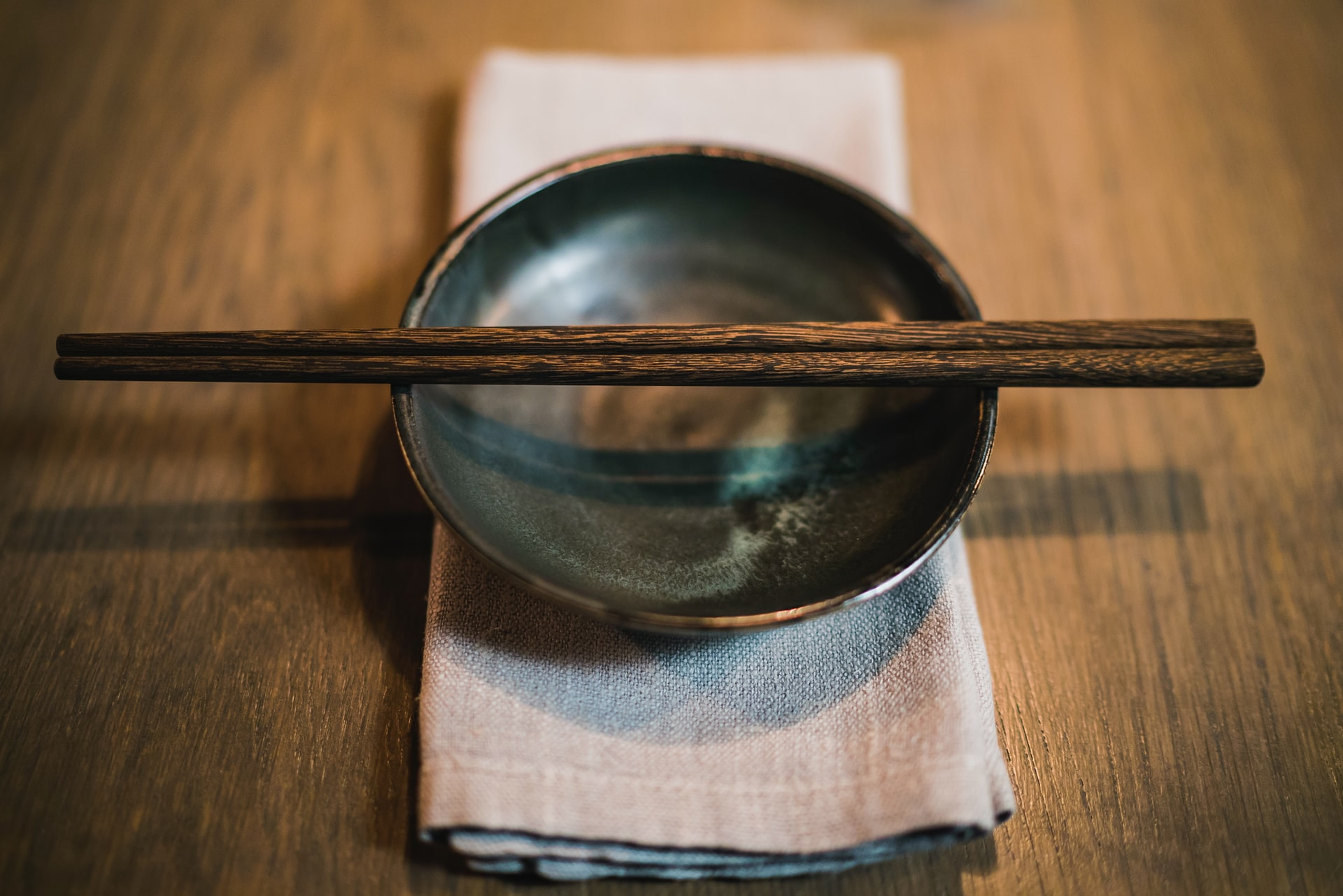 Properly oiled dark wooden bowl with matching chopsticks