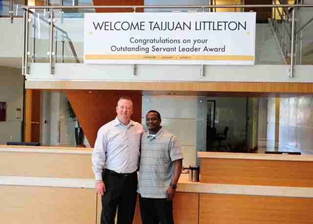 Rent-A-Center CEO Robert Davis (left) with Taijuan Littleton