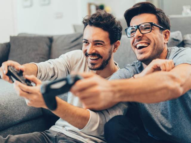 Two guys playing their favorite video games